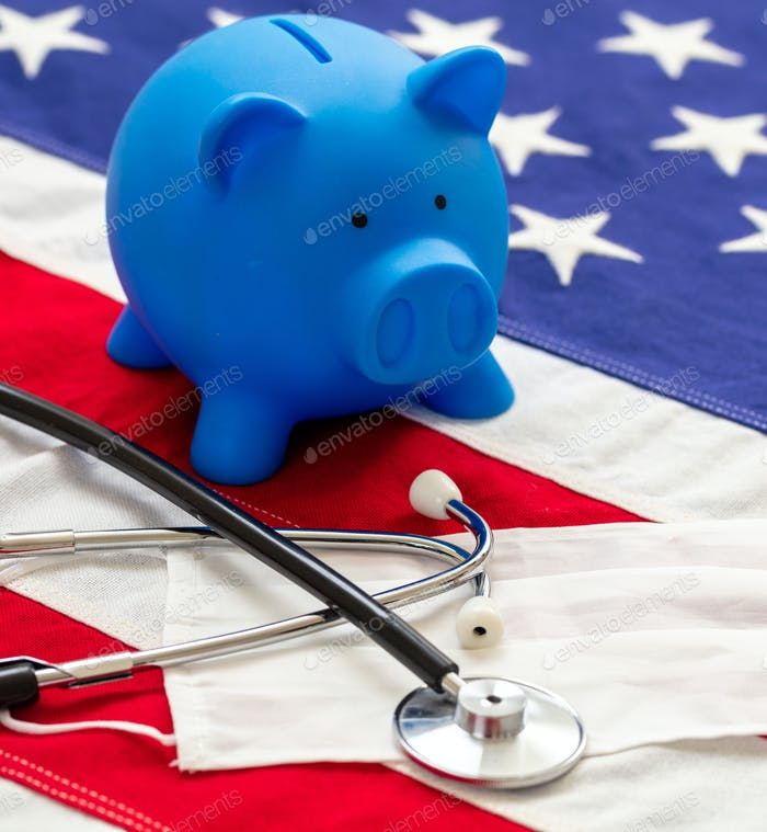 US of America health budget. Medical stethoscope, protective mask and piggy bank on a USA flag
