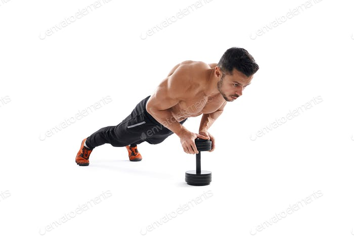 Bodybuilder doing push up using dumbbell