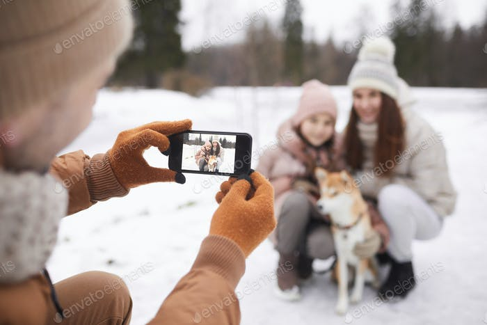Taking Photo of Family with Dog in Winter Park
