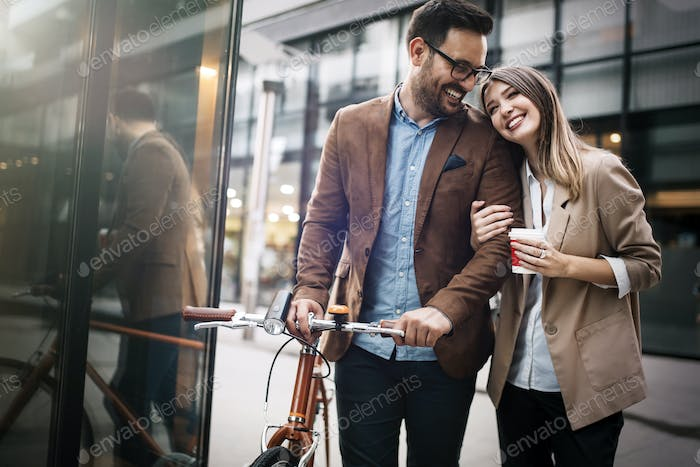 Loving couple walking, smiling having fun in the city