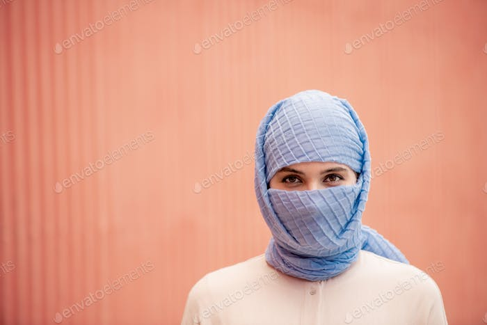Head and shoulders of young islamic female in hijab