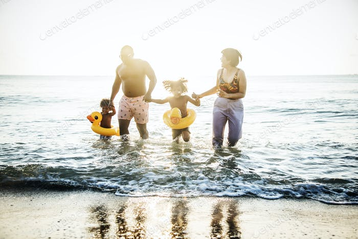 Family playing together at the beach