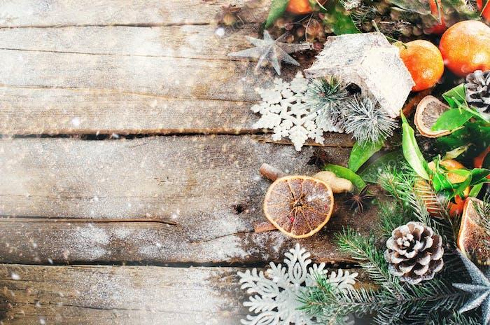 Magic Christmas background - vintage wood, candy cane, house, cinnamon, star anise, sweet mandarins