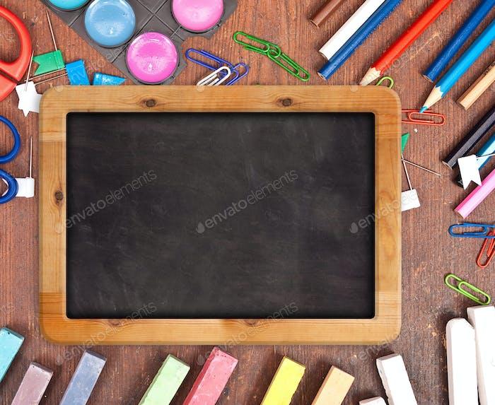 Chalk blackboard with school supplies