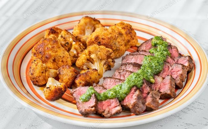 Sliced beef steak with baked cauliflower