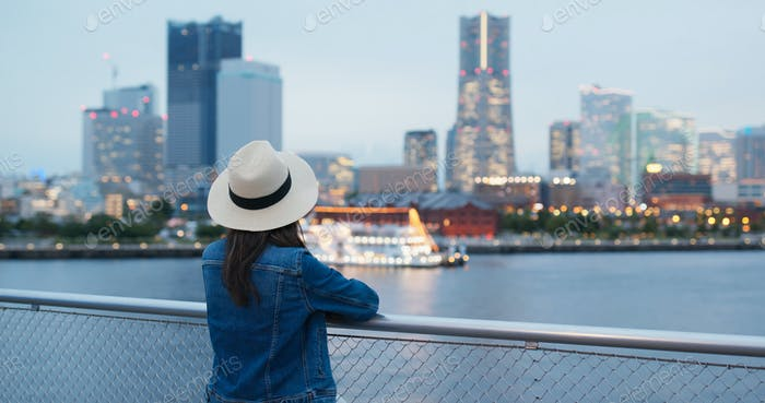 Woman look around in Yokohama city