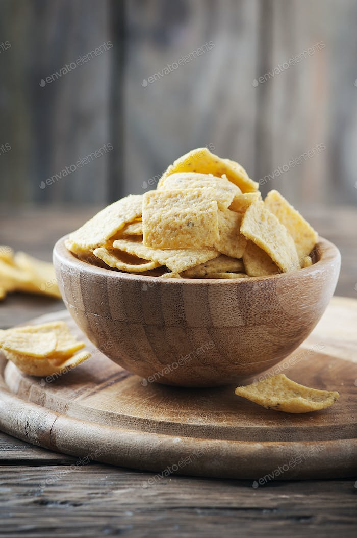 Traditional mexican mais chips on the wooden table