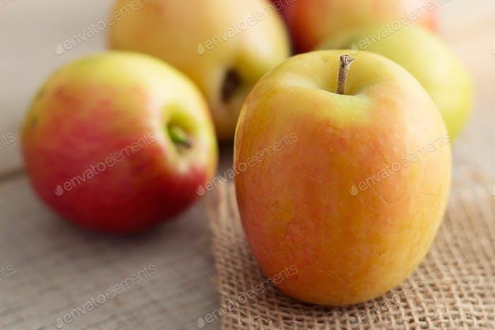 Fresh apples on wooden
