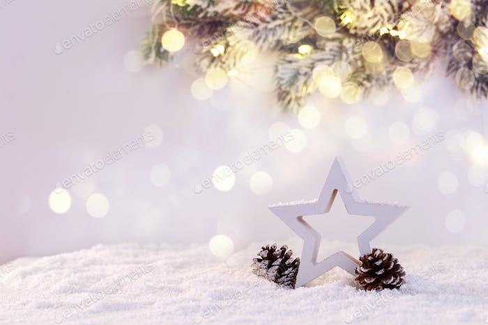 Wooden star on snow
