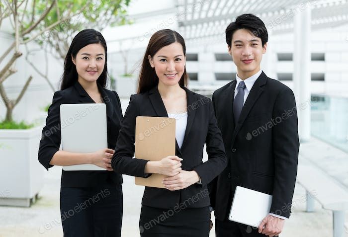 Confident business people hold with clipboard and digital device