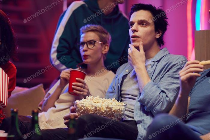 Man sitting with popcorn