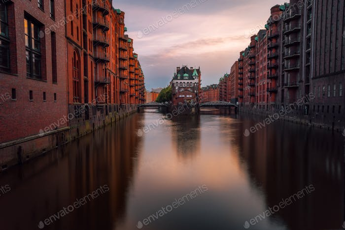 Hamburg, Warehouse District Speicherstadt. Germany, Europe. View of Wandrahmsfleet on evening light