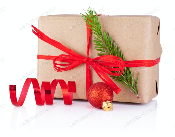 Christmas gift in kraft paper tied a red braid, pine tree branch