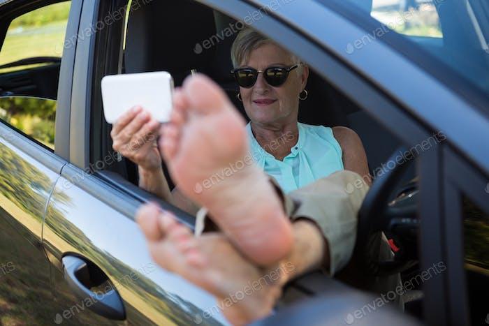 Senior woman taking selfie on mobile phone