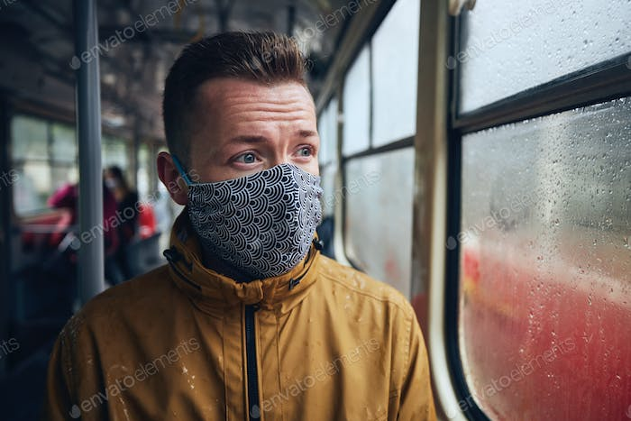 Man wearing face mask in public transportation