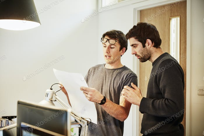two people discussing a design plan