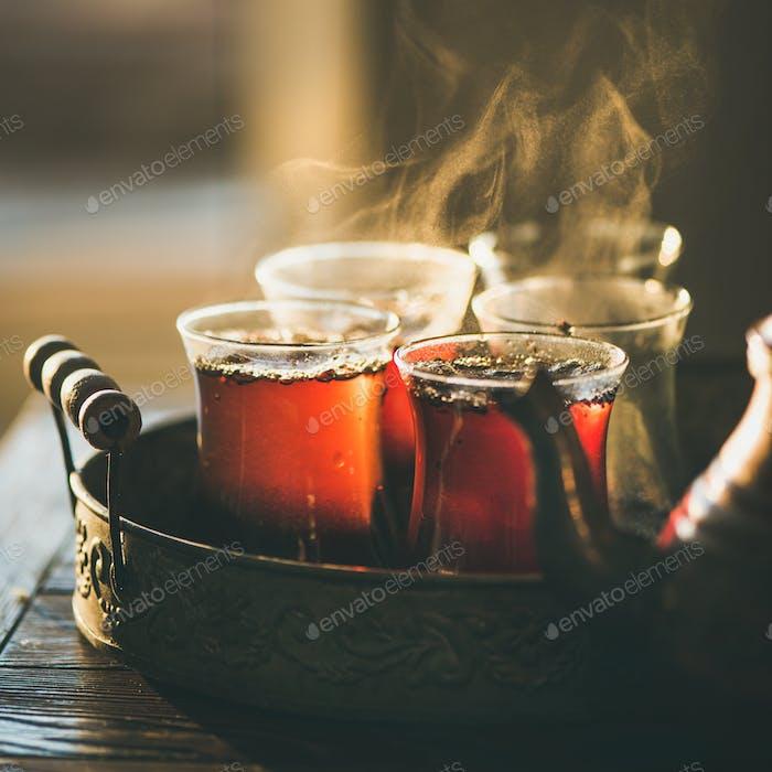Freshly brewed black tea in turkish glasses, square crop