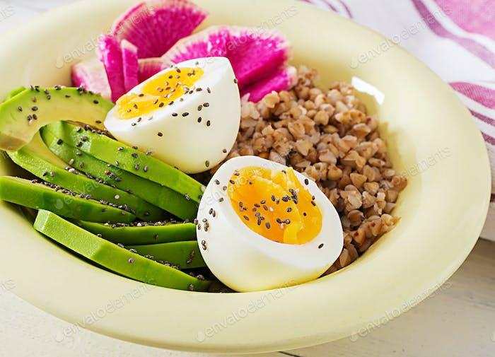 Buckwheat porridge buddha bowls with avocado, boiled eggs and  watermelon radish