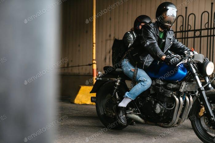 Photo of bearded men bikers wearing helmets sitting on their bikes