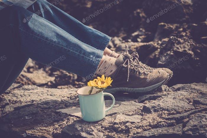 closeup of woman's trekking shoes on a rock