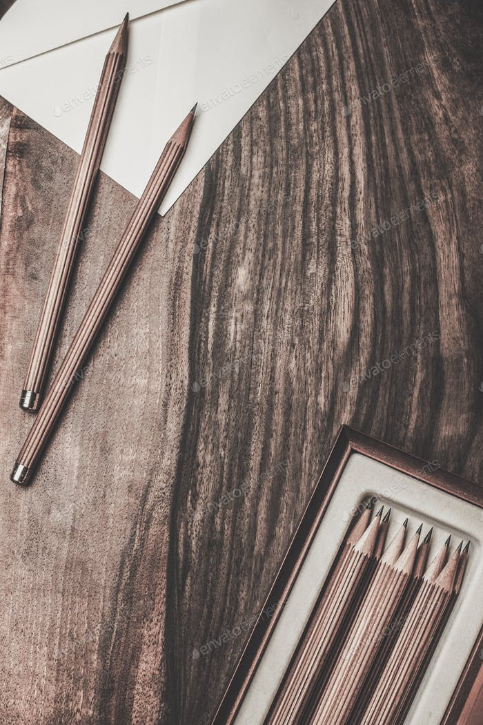 Luxurious charcoal drawing pencils on a wooden table
