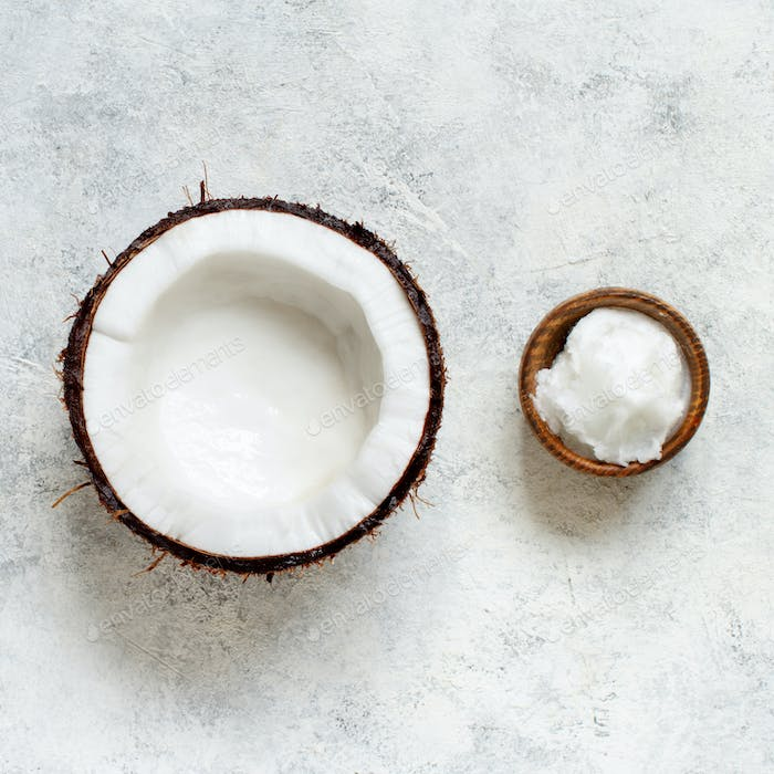 Coconut oil in a bowl and half of coconut