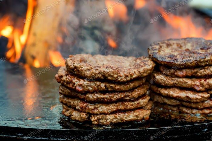 Fresh cooked beef burger patties