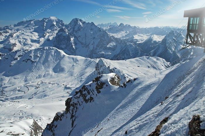 Ski lifts in the Dolomites. Ski piste and slopes. Passo Pordoi, Italy