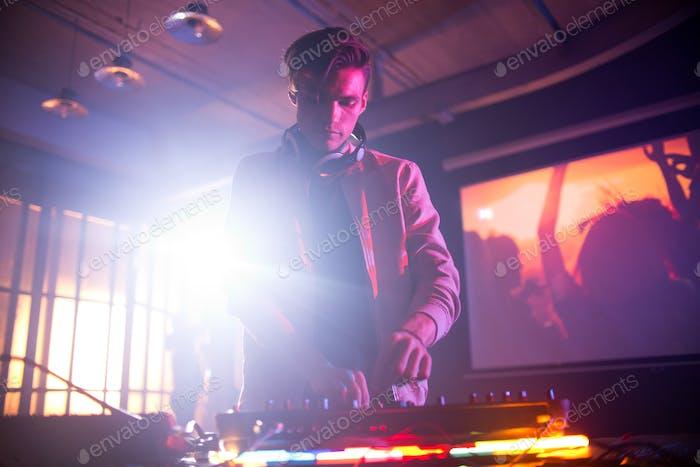Handsome DJ Focused on Work