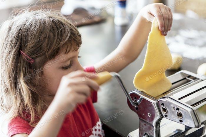 Girl Making Pasta