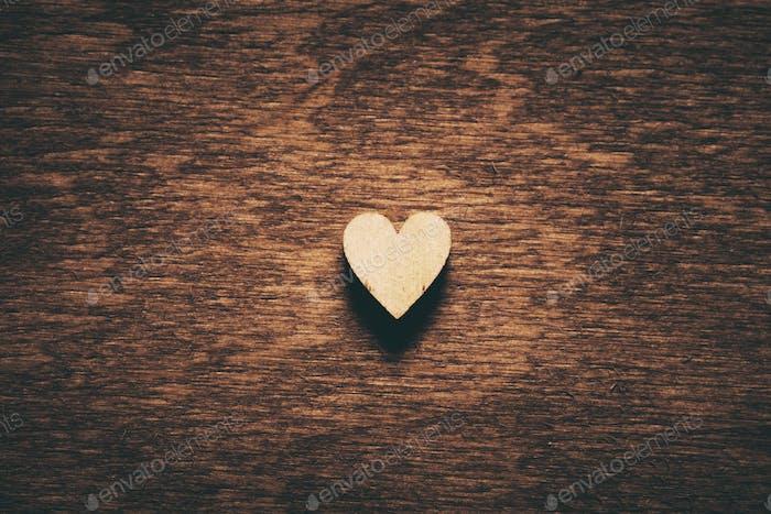 Heart on dark wooden background