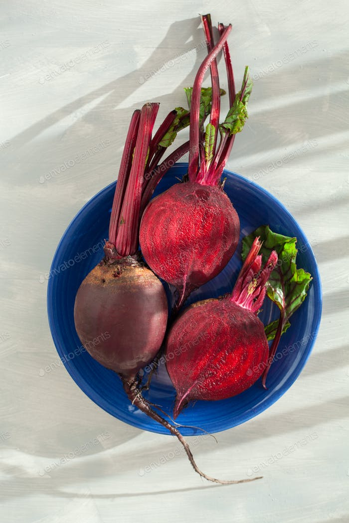 raw beetroot on wooden background