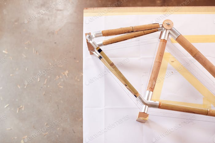 Hand Built Sustainable Bamboo Bicycle Frame Being Assembled In Workshop