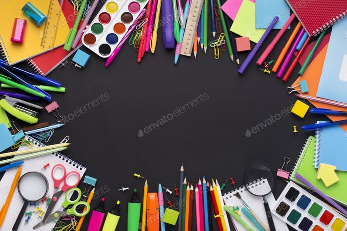 Modern school stationery on black board with blank space