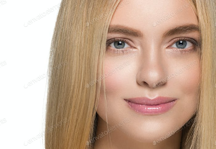 Woman with natural healthy skin and long blond hair beauty