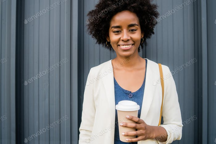 Portrait of afro business woman outdoors.
