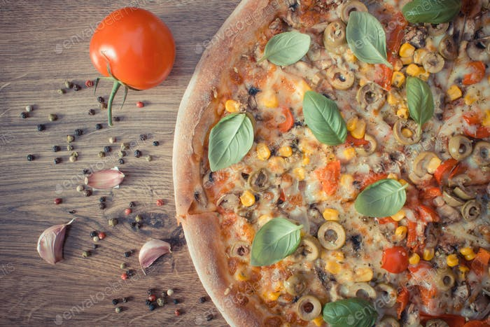 Vintage photo, Vegetarian pizza, ingredients and spices on rustic board