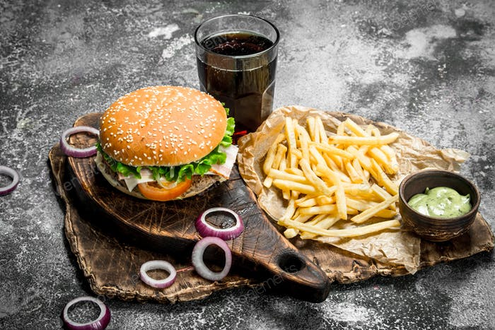 Street food. Burger with cola and fries.