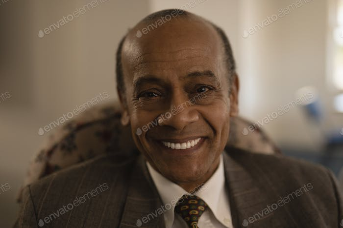Close-up of happy senior man looking at camera in nursing home