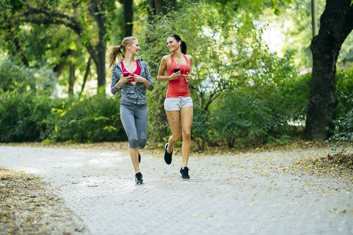 Energetic young women running outdoors