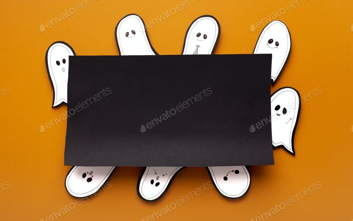 Paper ghost sitting around black table with copy space for text