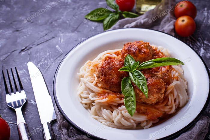 Spaghetti pasta with meatballs and tomato sauce.