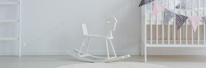 Baby's nursery with rocking horse