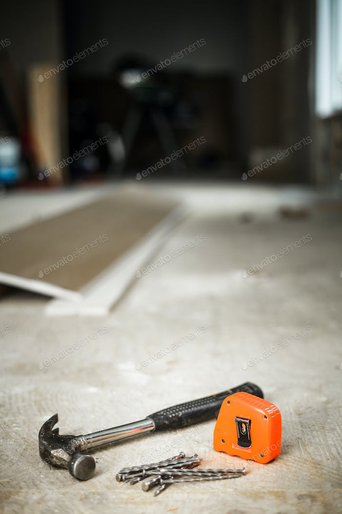 Hammer, Nails and Orange Measuring tape