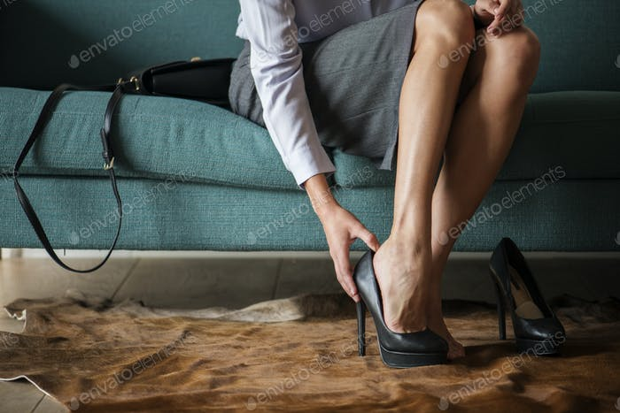 Woman taking off her high heels