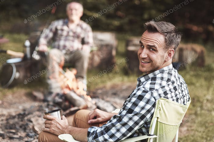 Man sitting in his chair in forest