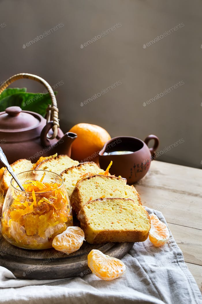 Tangerine cake with tea background