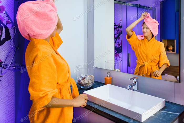Girl standing in a robe after a morning shower