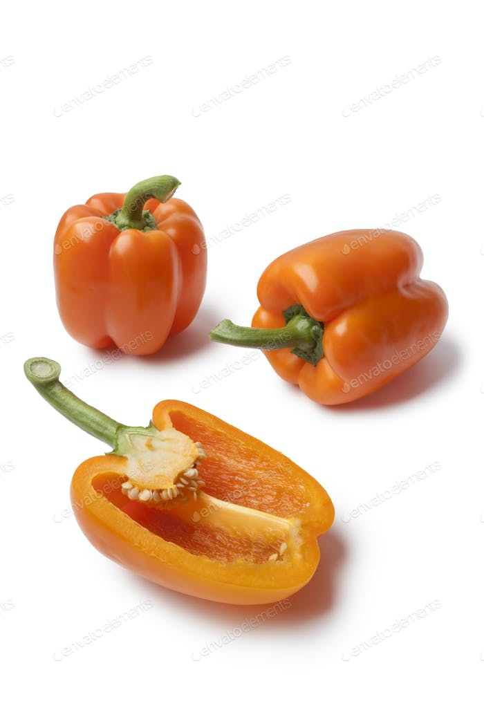 Whole and half orange bell peppers