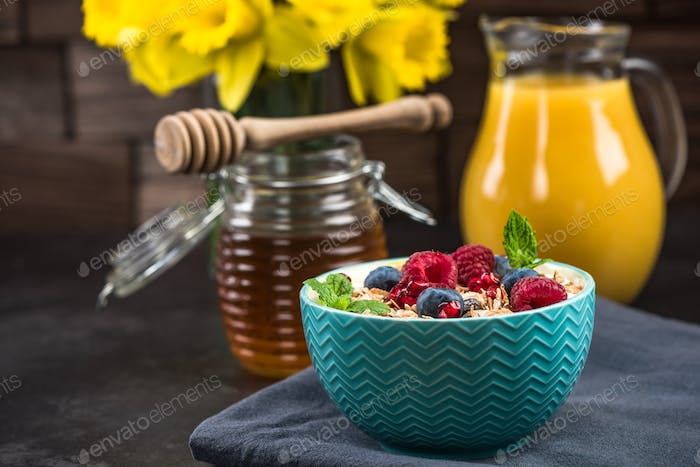 Muesli in bowl with fresh berry fruits
